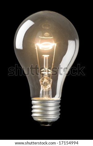 Light bulb on low isolated on a black background - stock photo
