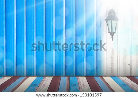 Light bulb on the wooden wall under the sunshine - stock photo