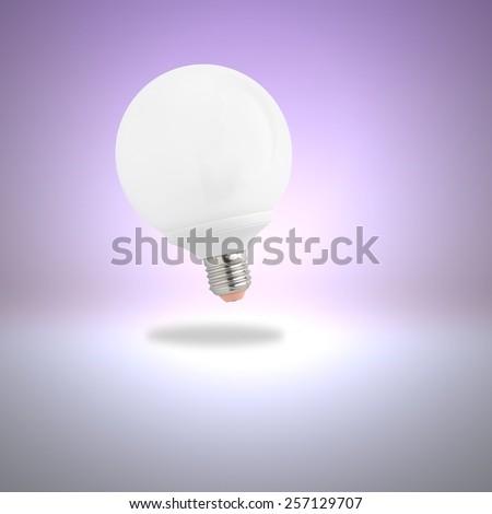 Light bulb on violet background - stock photo