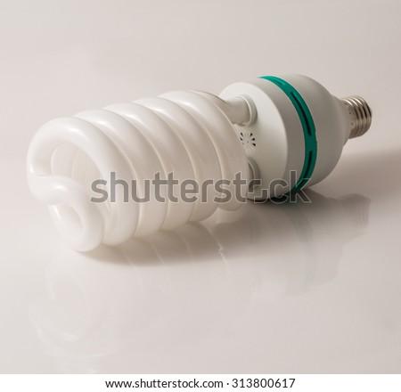light bulb on white table - stock photo