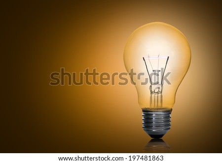 light bulb on yellow background. - stock photo