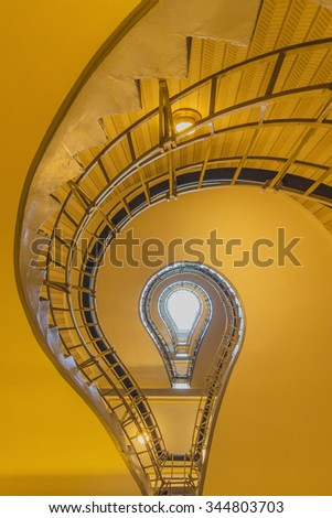 light bulb shaped cubism staircase in historical building in the centre of old Prague - stock photo