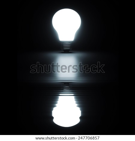 Light bulb shiny rendered with reflection on black bakground - stock photo