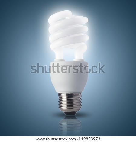 Light bulb turn on with blue background - stock photo