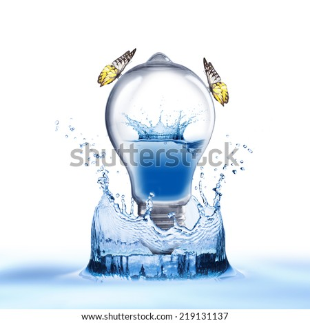 Light bulb water splash inside the bulb. Concept for environment conservation - stock photo