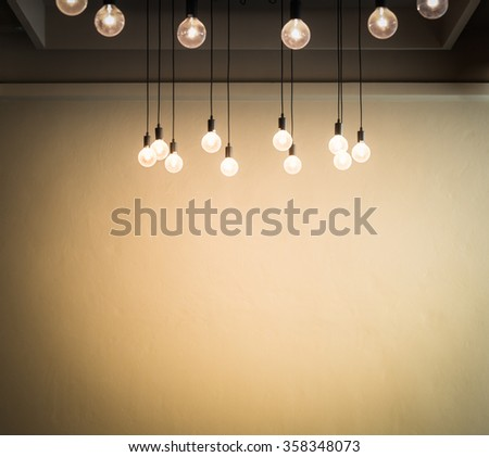 Light bulb with cement wall background,space for text - stock photo