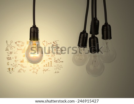 Light bulb with drawing graph - stock photo