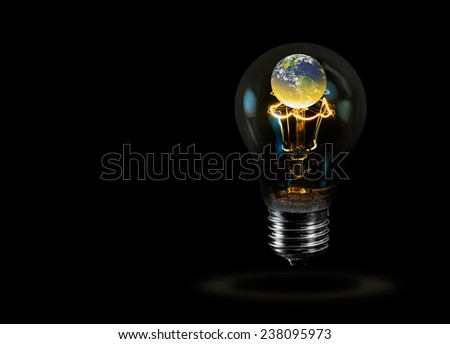 """Light bulb with world inside and global warming isolated on black""""Elements of this image furnished by NASA """"  - stock photo"""