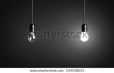 Light bulbs on black background - stock photo