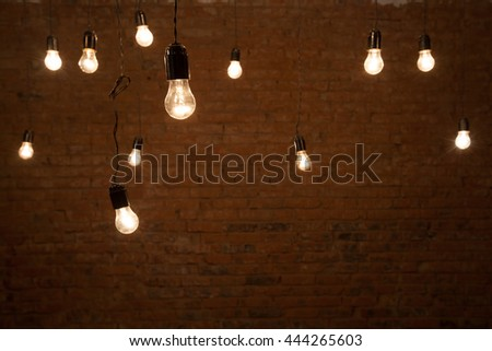 Light bulbs over brick all texture - stock photo