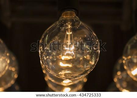 Light bulbs with base in a row. - stock photo