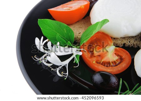 light cheese with vegetables on bread over white - stock photo