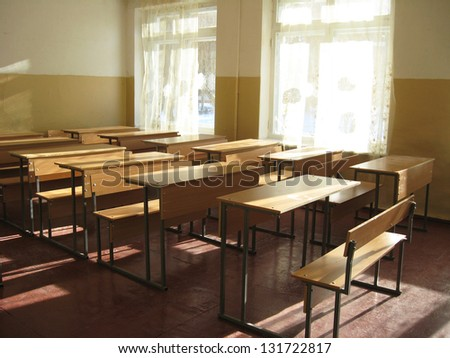 light classroom with a lot of desks - stock photo