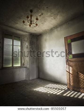 Light falls trough the window creating an amazing atmosphere with the shades on the floor. - stock photo