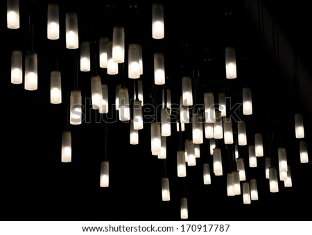 Light fixtures suspended from ceiling   - stock photo