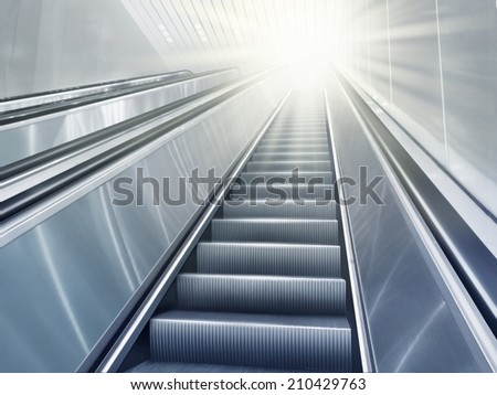 Light-flooded escalator - stock photo