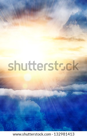 Light from above, bright sun, blue sky and clouds - stock photo