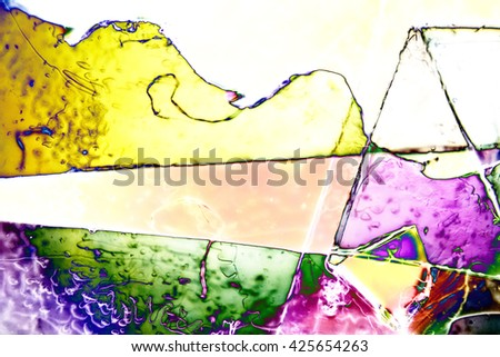 Light Graphics: Microphoto of translucent structures in polarized light - stock photo