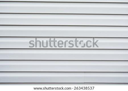 Light gray vinyl siding background. - stock photo
