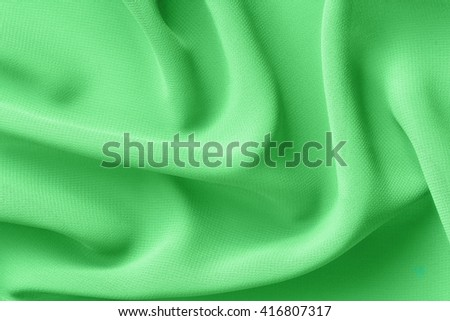 light green fabric with large folds abstract background - stock photo