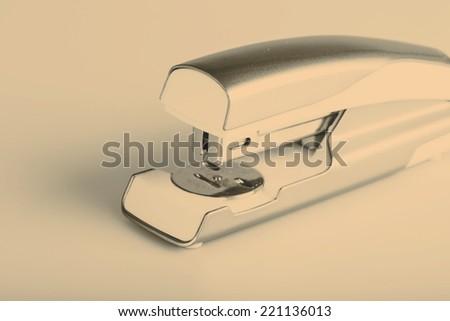 Light green stapler isolated on white background - stock photo