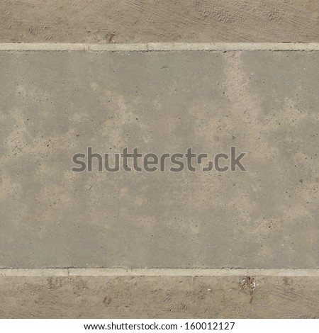 Light grey road made of asphalt with slightly rough surface and sand at edges. - stock photo