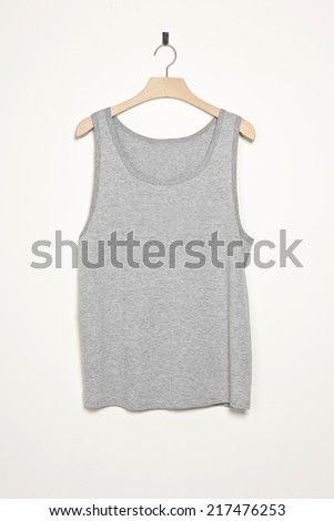 light grey t-shirts with wood hanger isolated white. - stock photo