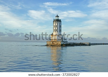 Light house at Port of Los Angeles, California jetty landscape on a calm morning                       - stock photo