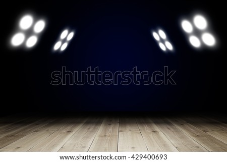 Light in dark room with wooden floor. Copy space for your products - stock photo