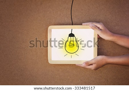 light in frame and hand hold concept idea - stock photo