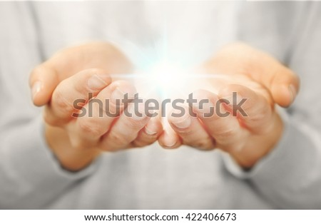 Light in hands.  Concept of taking, care, protection - stock photo