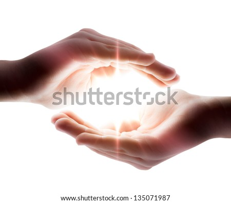 light in the hands - stock photo