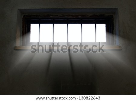 Light is coming through the barred window, hope concept - stock photo