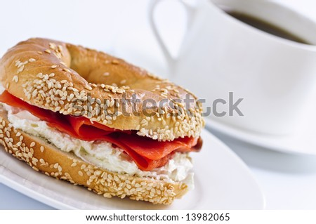 Light meal of smoked salmon bagel and coffee - stock photo