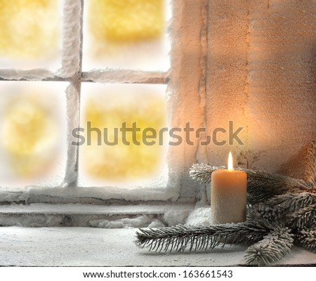 light of candle and window  - stock photo