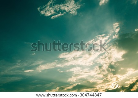 light of sunbeam on blue sky background with clouds, image used filter vintage - stock photo