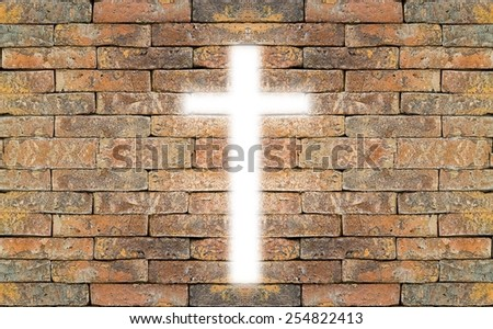 Light of the World. Cross on a brick wall with copy space. - stock photo