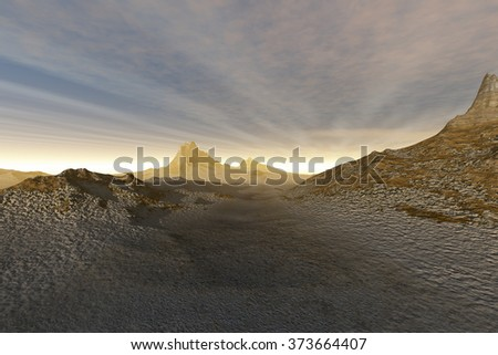 light on the horizon, a rocky landscape, mountain desert, haze in atmosphere and a cloudy sky. - stock photo