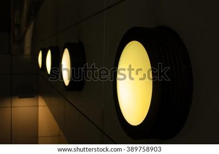 Light on the wall. night lighting - stock photo