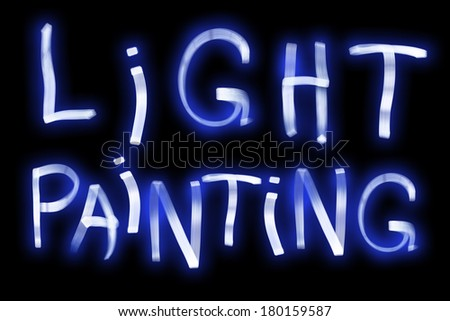 Light Painting words using a LED light panel at night and a long exposure. - stock photo