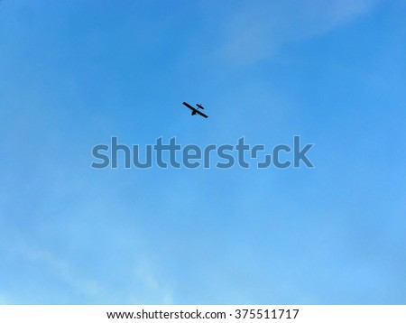 light private airplane against blue sky       - stock photo