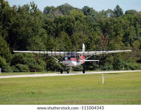 Light private airplane taxiing for takeoff - stock photo