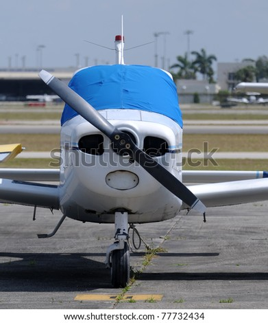 Light private propeller airplane front view - stock photo