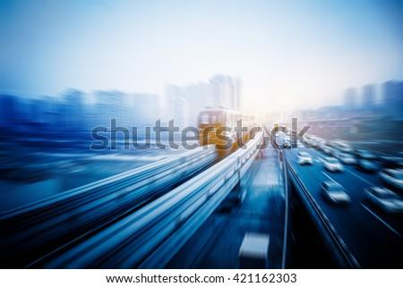 light rail moving on railway in chongqing - stock photo