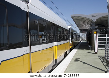 light rail train departing station - stock photo