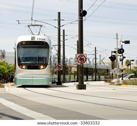 Light rail train of the Phoenix Metro system photographed in Tempe Arizona. - stock photo