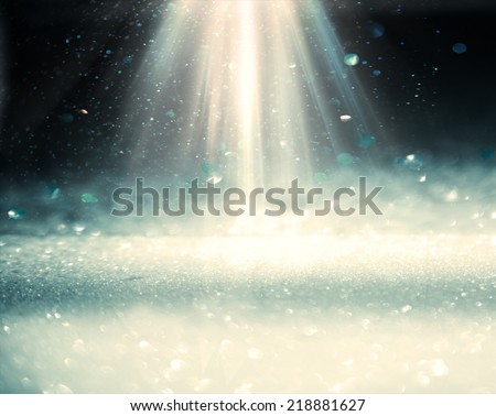 Light rays from top on the black blurren plane with bekeh lights - stock photo