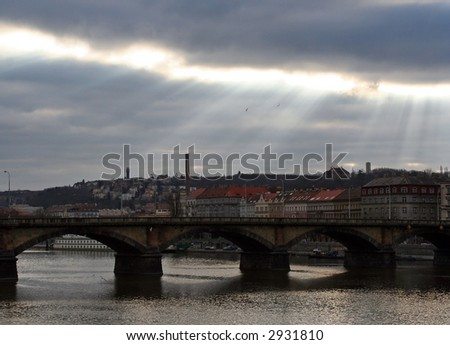 Light rays over the old European city - stock photo
