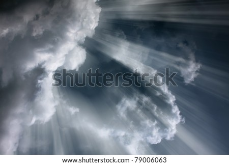 Light rays shine through the dark clouds/Overcast sky before storm - stock photo