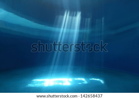 Light rays shining through water, great for your design - stock photo